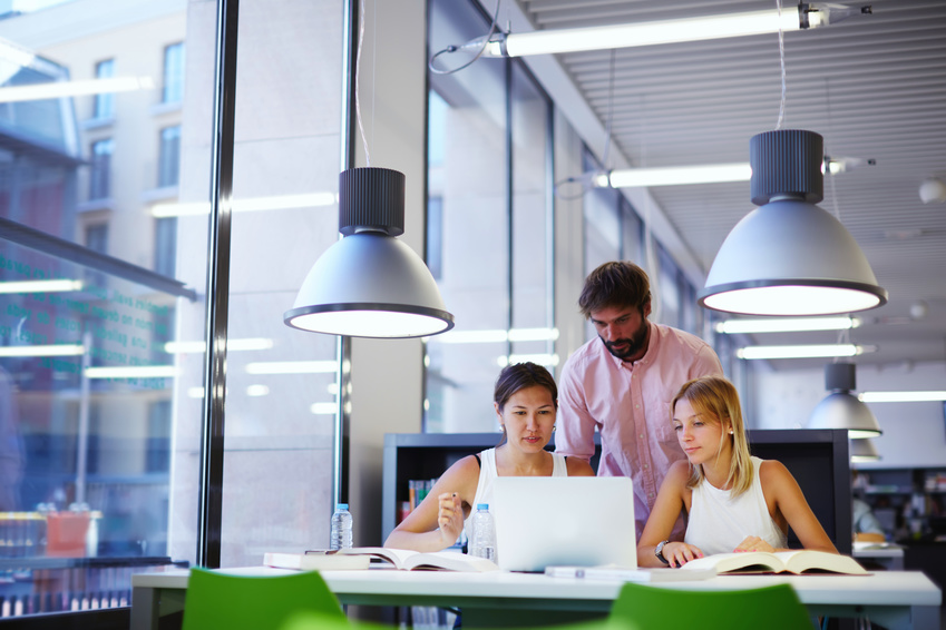 Group of freelancers working together in modern cowering space