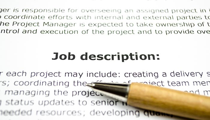 Pencil laying over a job description
